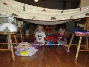 toddlers under blanket fort