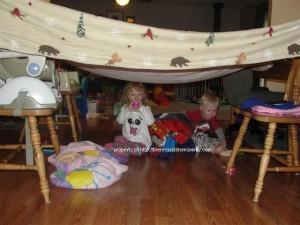 toddlers under blanket fort