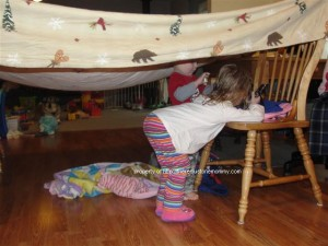 kids with blanket fort