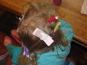 toddler with lots of bows