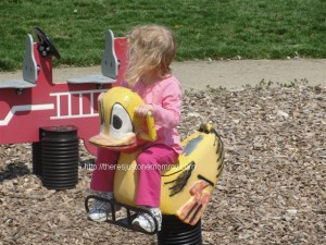 girl on toy duck