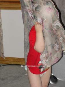 toddler playing peek-a-boo