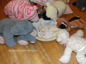 stuffed animals eating dinner