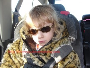 My little movie star, stylin' in the back seat