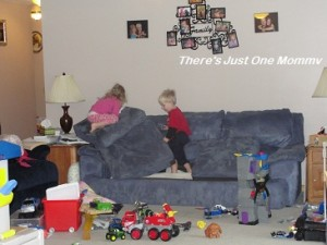 This would drive my mom nuts.... Notice the toys all over the floor?  And the kids using the cushions to build a mountain to climb?