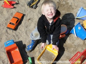 playing trucks in the sand
