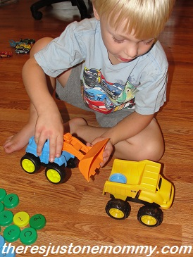 how to use toy trucks in a fun preschool alphabet activity