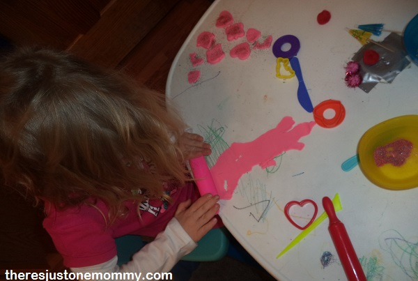 rolling out play dough cookies for pretend play