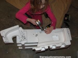hammering nails in styrofoam