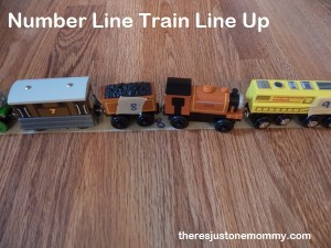 practicing counting and number skills with toy trains