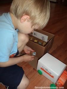 preschooler alphabet activity with trucks