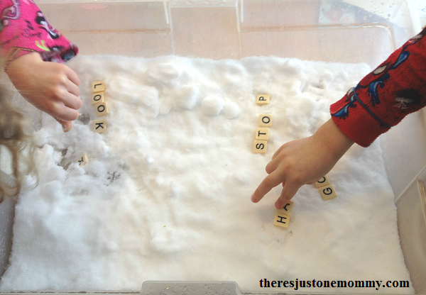 working on spelling and sight words using tiles in the snow