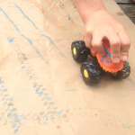 painting with toy trucks