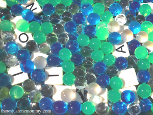 using water beads for spelling word practice