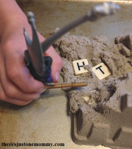 spelling practice fun with kinetic sand