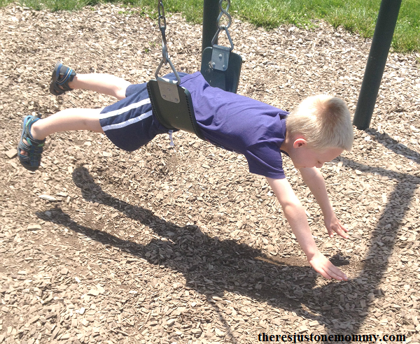 using a playground swing to strengthen core muscles in kids