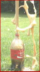 kids science experiment: how to make a Coke and Mentos geyser; fun STEM activity for summer