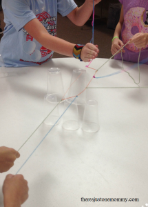 fun team building activity: build a cup pyramid without using your hands in this team work challenge
