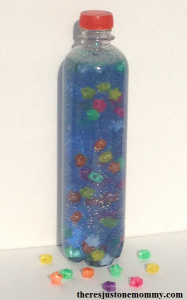 Floating Star Sensory Bottle -- sensory bottle made with hair gel; when shaken the floating star beads slowly rise to the top of the bottle