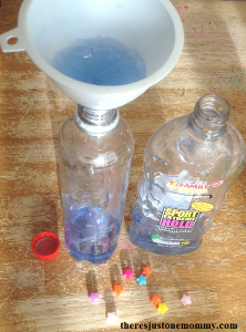 sensory bottle using hair gel -- when shaken the floating star beads slowly rise to the surface