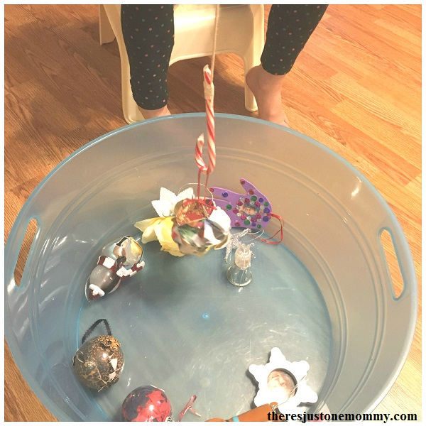candy cane fishing game -- fun Christmas Minute to Win It kids Christmas activity