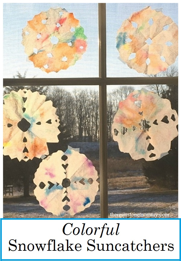 colorful snowflake suncatcher craft for kids