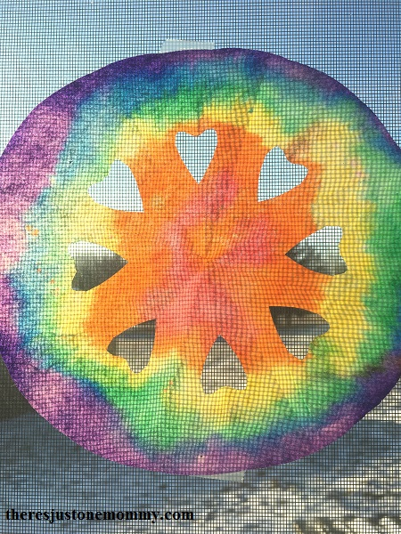 beautiful tie-dyed snowflake craft; coffee filter suncatcher