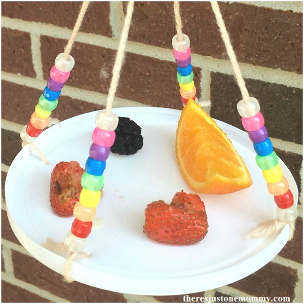 simple beaded butterfly feeder made with plastic lid