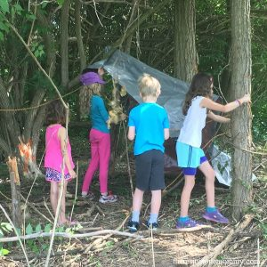 simple STEM challenge for kids: build an outdoor shelter