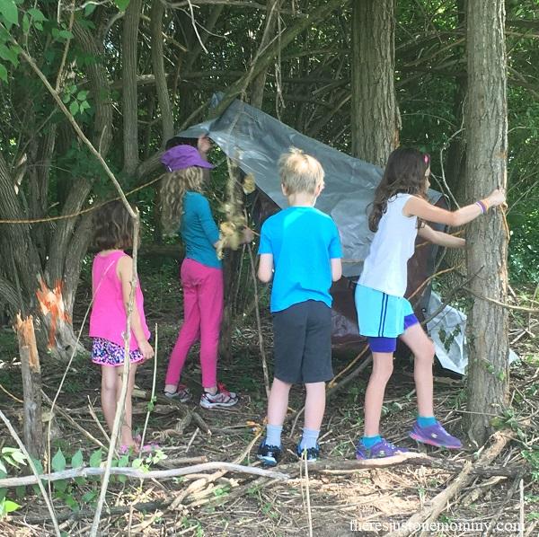 simple STEM challenge for kids: build an outdoor shelter