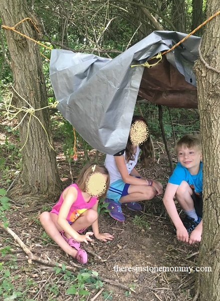teaching kids survival skill with building a shelter