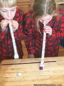 kids New Year's game -- pom-pom races
