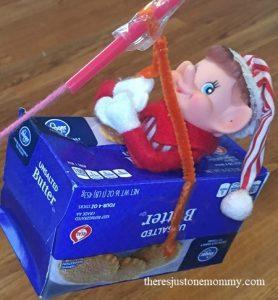 elf on a shelf activity -- make a zipline for the elf