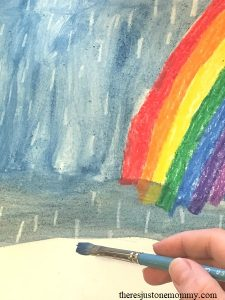 Looking for a simple April showers craft for kids? Try crayon resist painting!