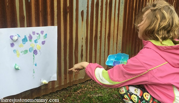cotton ball splat painting -- fun and messy outdoor art for kids