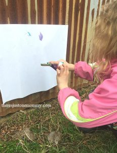 splat painting using a catapult and cotton balls