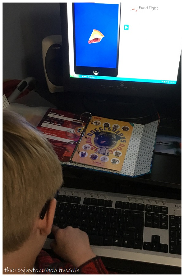 child learning computer coding