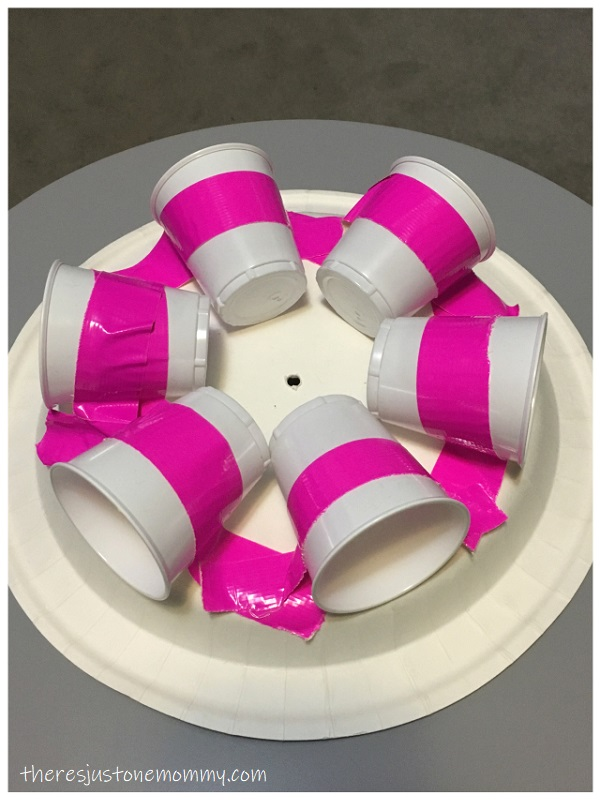 photo of plastic cups taped to paper plate to make a water wheel