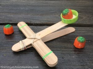 Halloween craft stick catapult with pumpkins